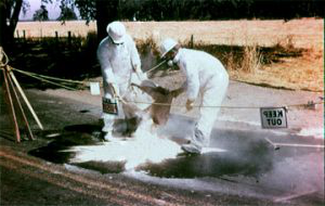 Two men cleaning up a spill