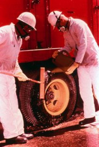 Men scrubbing a wheel during cleanup