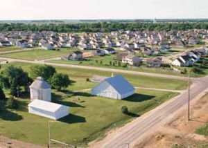 new homes replacing farmland on the edge of town