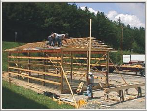 Workers framing a storage building