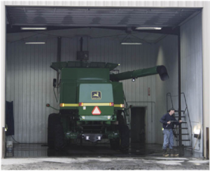 man washing a combine